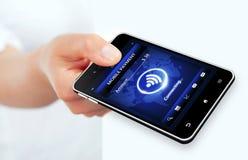 Τηλέφωνο εκμετάλλευσης χεριών με την κινητή σύνδεση πληρωμής Στοκ Φωτογραφίες