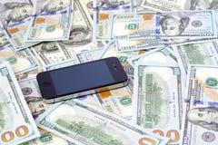 Τηλέφωνο και μετρητά Στοκ Φωτογραφία