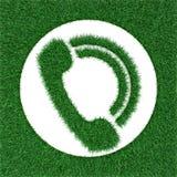 Τηλέφωνο λογότυπων από τη χλόη Στοκ φωτογραφίες με δικαίωμα ελεύθερης χρήσης