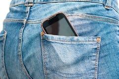 Τηλέφωνο στην πίσω τσέπη Στοκ εικόνες με δικαίωμα ελεύθερης χρήσης