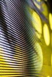 Τηλεοπτικός τοίχος των φωτεινών χρωματισμένος οδηγήσεων με το υψηλό διαποτισμένο σχέδιο - clos Στοκ Φωτογραφίες
