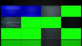 Τηλεοπτικός τοίχος TV με την οθόνη δώδεκα τηλεόρασης που επιδεικνύει το θόρυβο και που αλλάζει στον πράσινο σύντροφο οθόνης απόθεμα βίντεο