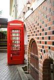Τηλεφωνικός θάλαμος του κόκκινου χρώματος Στοκ εικόνα με δικαίωμα ελεύθερης χρήσης