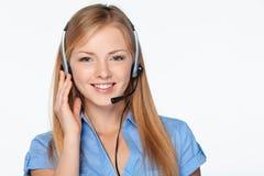 Τηλεφωνικός χειριστής υποστήριξης γυναικών στην κάσκα Στοκ Φωτογραφίες