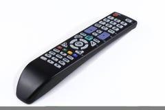 Τηλεχειρισμός TV σχετικά με το λευκό Στοκ φωτογραφία με δικαίωμα ελεύθερης χρήσης