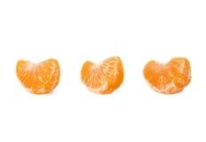 Τμήματα φετών tangerine που απομονώνονται πέρα από Στοκ Φωτογραφία