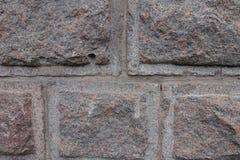 Τοίχος γρανίτη που γίνεται στην τεχνική rustication Στοκ Εικόνες