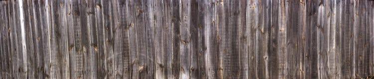 Τοίχος ενός σπιτιού με ένα σπίτι κούτσουρων, εκλεκτής ποιότητας ξύλινη σύσταση στη υψηλή ανάλυση Στοκ Φωτογραφία