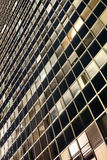 Περίληψη νύχτας τοίχων κουρτινών ουρανοξυστών Στοκ Φωτογραφίες