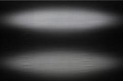 Τοίχος μετάλλων με τις αόρατες πηγές φωτός που φωτίζουν το midd Στοκ φωτογραφίες με δικαίωμα ελεύθερης χρήσης