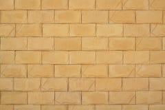 Τοίχος του κίτρινου υποβάθρου πλινθοδομής στοκ εικόνα