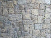 Τοίχος των γκρίζων πετρών, paralelepipedo, γκρίζο υπόβαθρο, σχέδιο με τις γκρίζες πέτρες στοκ εικόνα