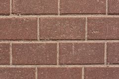 Τοίχος των κόκκινων τούβλων γρανίτη Στοκ Εικόνες
