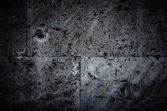 Τοίχος των νέων γκρίζων τούβλων ανασκόπηση αστική τονισμένος Στοκ Φωτογραφίες