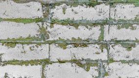 Τοίχος φιαγμένος από εκλεκτής ποιότητας τούβλα, παλαιά σύσταση των φραγμών πετρών στοκ εικόνα με δικαίωμα ελεύθερης χρήσης