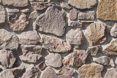 Τοίχος φιαγμένος από πέτρες γρανίτη ως υπόβαθρο Στοκ φωτογραφίες με δικαίωμα ελεύθερης χρήσης