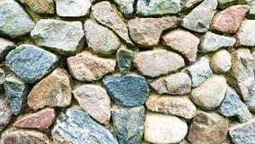 Τοίχος φιαγμένος από φυσικό υπόβαθρο πετρών Στοκ εικόνες με δικαίωμα ελεύθερης χρήσης