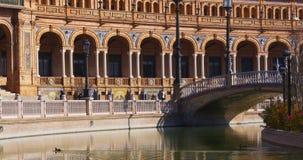 Τοίχος 4k Ισπανία γεφυρών ήλιων της Σεβίλης light plaza de espana απόθεμα βίντεο