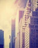 Τονισμένη τρύγος φωτογραφία των ουρανοξυστών στο Μανχάταν στο ηλιοβασίλεμα, NYC, στοκ φωτογραφίες