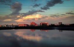 Τοπίο πόλεων στο ηλιοβασίλεμα Στοκ Εικόνες