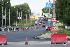 Τοποθέτηση της ασφάλτου στο δρόμο Στοκ Εικόνα