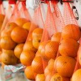 Τοποθετημένα σε σάκκο πορτοκάλια Στοκ Εικόνα