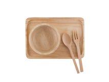 Τοπ άποψη, ξύλινο κουτάλι και ξύλινο φλυτζάνι που τοποθετούνται στον ξύλινο δίσκο Στοκ Εικόνα