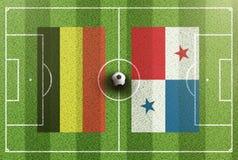 Τοπ άποψη του πράσινου γηπέδου ποδοσφαίρου με τις σημαίες του Βελγίου και του Παναμά Στοκ Εικόνες