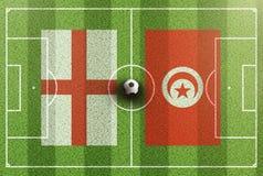 Τοπ άποψη του πράσινου γηπέδου ποδοσφαίρου με τις σημαίες της Αγγλίας και της Τυνησίας Στοκ φωτογραφίες με δικαίωμα ελεύθερης χρήσης