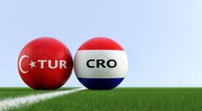 Τουρκία εναντίον Αγώνας ποδοσφαίρου της Κροατίας - σφαίρες ποδοσφαίρου στα εθνικά χρώματα της Τουρκίας και της Κροατίας σε ένα γή διανυσματική απεικόνιση