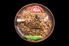 Τουρκικά τρόφιμα Άγκυρα Tava/κρέας αρνιών στο μαύρο υπόβαθρο Στοκ Εικόνα