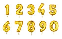 Τους ρεαλιστικούς αριθμούς μπαλονιών καθορισμένους το χρυσό χρώμα απεικόνιση αποθεμάτων
