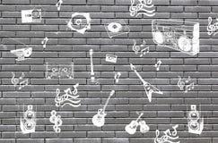 Τούβλα με τα σύμβολα της μουσικής Στοκ Εικόνες