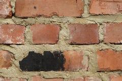 τούβλα που γίνονται τον τοίχο Στοκ Εικόνα