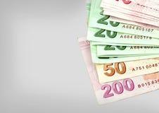 Τούρκος τραπεζογραμματί Τουρκική λιρέτα (TL) στο γκρίζο υπόβαθρο Στοκ Εικόνες