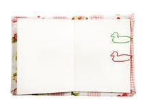 Το άσπρο σημειωματάριο με διακοσμεί paperclip Στοκ Εικόνες