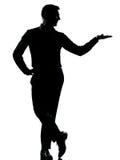 το άτομο ένα επιχειρησιακών χεριών ανοίγει τη σκιαγραφία Στοκ φωτογραφία με δικαίωμα ελεύθερης χρήσης