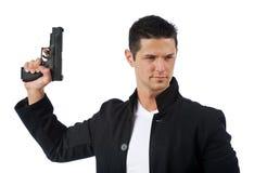 Το άτομο απομόνωσε στο λευκό που κρατά ένα πυροβόλο όπλο χεριών Στοκ Φωτογραφία