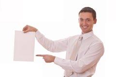 Το άτομο εμφανίζει δάχτυλο σε κενό χαρτί Στοκ Εικόνες