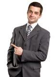το άτομο επιχειρησιακών δάχτυλων εμφανίζει κάτι Στοκ Εικόνες