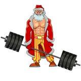 Το άτομο με τους αντλημένους μυς έντυσε όπως Άγιος Βασίλης στέκεται με το barbell Στοκ Φωτογραφίες