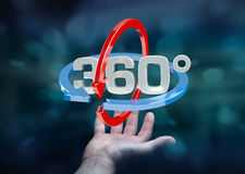 Το άτομο που κρατά 360 βαθμός τρισδιάστατο δίνει το εικονίδιο στο han του Στοκ Φωτογραφία