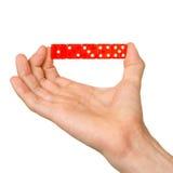 Το άτομο που κρατά το κόκκινο πέντε χωρίζει σε τετράγωνα Στοκ Εικόνες