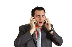 το άτομο που συγκλονίζεται τηλεφωνά σε δύο Στοκ Φωτογραφία