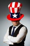 Το άτομο που φορά το καπέλο με τα αμερικανικά σύμβολα Στοκ Εικόνες