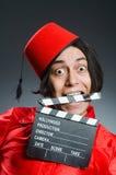Το άτομο που φορά το κόκκινο καπέλο του Fez Στοκ φωτογραφίες με δικαίωμα ελεύθερης χρήσης