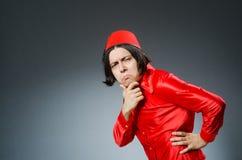 Το άτομο που φορά το κόκκινο καπέλο του Fez Στοκ Φωτογραφίες