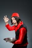 Το άτομο που φορά το κόκκινο καπέλο του Fez Στοκ εικόνα με δικαίωμα ελεύθερης χρήσης