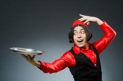 Το άτομο που φορά το κόκκινο καπέλο του Fez Στοκ Εικόνα