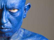 Το άτομο προσώπου χρωμάτισε του μπλε χρώματος Στοκ εικόνες με δικαίωμα ελεύθερης χρήσης